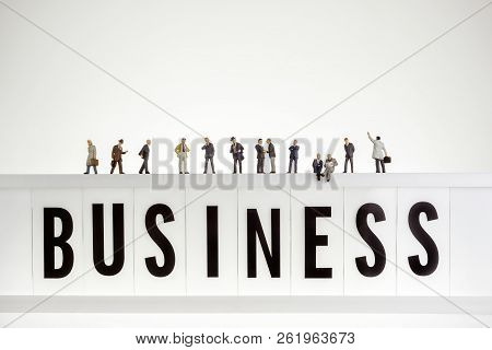 Business Word With Crowd Of Miniature Business People.