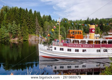 ULEFOSS, NORWAY - JULY 18, 2018: M/S Henrik Ibsen ferry boat on the Telemark Canal during a unique historical boat trip through spectacular Norwegian nature