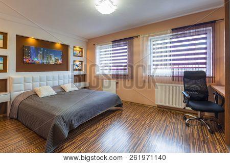 Brown and beige master bedroom interior