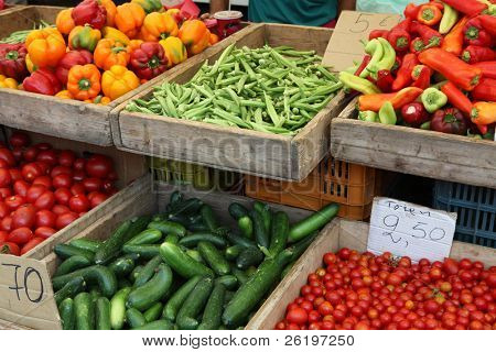 Vegetables on sale at a greek market stall - okra, cucumber,cherry tomatoes, plum tomatoes, capsicums and peppers,