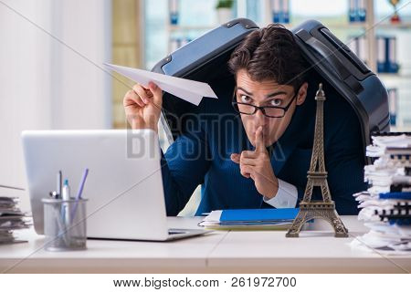 Employee thinking of vacation due to excessive workload poster
