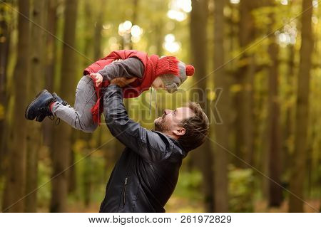 Little Boy With His Father During Stroll In The Forest. Active Family Time On Nature. Fun With Littl