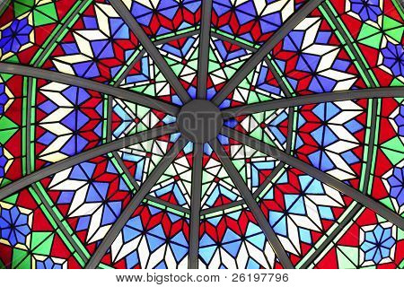 Abstract detail of the stained glass cupola roof over part of an arcade in Souq Waqif, Doha, Qatar