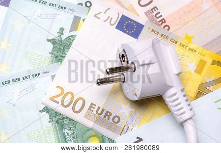 Electrician Close-up On Euro Banknotes. The Concept Of Savings On Electricity