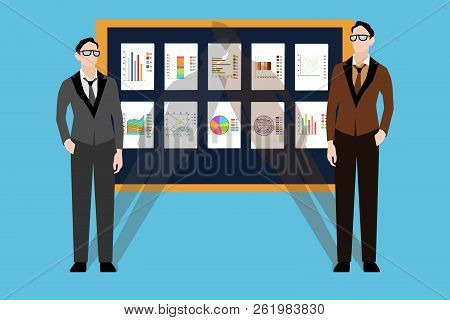 Two Young Businessmen Are Standing In Front Of A Blackboard With Financial Charts. Businessmen Prese