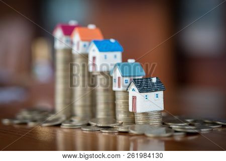 Mini House On Stack Of Coins,money And House, Real Estate Investment, Save Money With Stack Coin, Mo