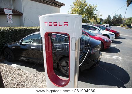 October 7 - Beulton, Ca:  Model 3 And Other Teslas Charge At The Supercharger Staion In Beulton, Ca