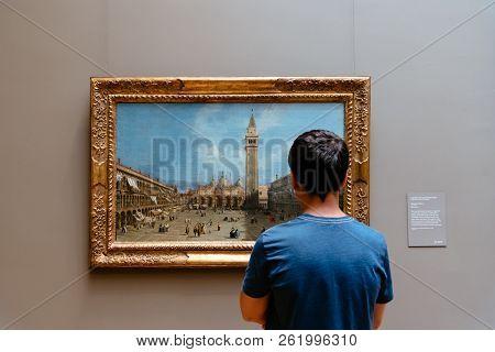 New York City, Usa - June 23, 2018: Teenager Looking At Painting At Metropolitan Museum Of Art. The