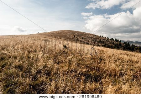 Autumn Mountain Meadows With Blue Sky And Clouds And Other Hills On The Background - View To Kecka H