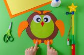 making of diy lantern for sankt martin, traditional german feast, childs hands and owl of color paper, glue, scissors, lanterns wand poster