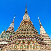 Phra Maha Chedi Si Rajakarn is a 42m high stupa in Wat Pho Buddhist temple complex in Bangkok, Thailand poster