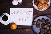 Mindless snacking, conscious nutrition, overeating, sugar addiction, stress, compulsive eating. Inscription Why we eat this and sweets on table, flat lay poster