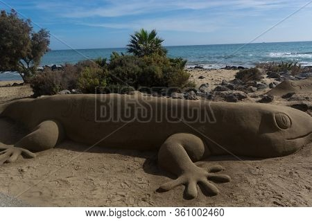 Sand Sculptures On The Beach Of Meloneras, Spain With Inscription Gran Canaria