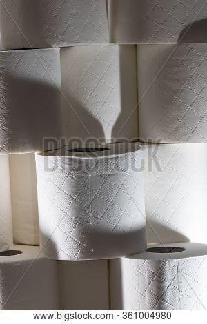 Sinister Generic Toilet Roll Background Image. Coronavirus Covid-19 Hoarding. Stack Of Loo Rolls. So