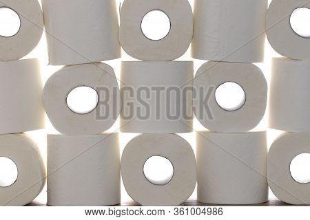 Toilet Paper Background Image. Stack Of Loo Rolls Against White Background. Coronavirus Covid-19 Mas