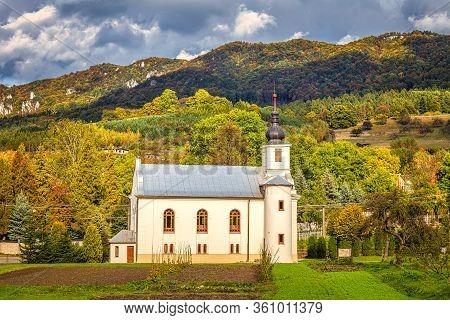 Church In Sulov - Hradna With Background Of Sulov Rocks At Autumn, Slovakia, Europe.