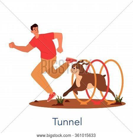 Dog Agility Tunel. Training Exercise For Pet. Man Training His Pet Dog.