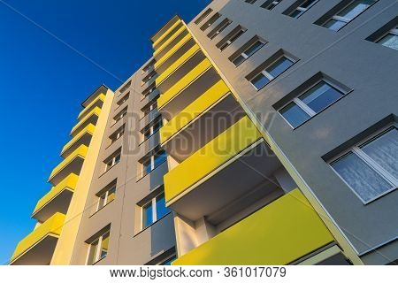 Facade Of A Renovated Apartment Block Of Flats With Balconies.