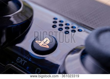Brecht, Belgium - April 13 2020: A Close Up Portrait Of The Playstation Home Button On A Ps4 Wireles