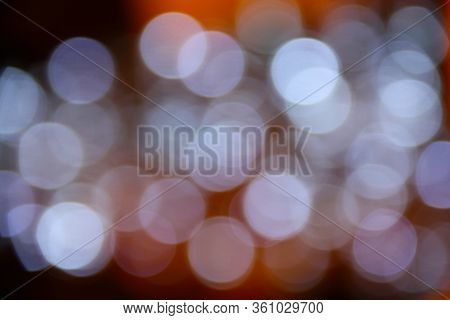 Abstract Christmas Background With Blurred Blue Circles Of Light