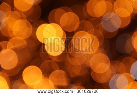 Abstract Christmas Background With Yellow Blurred Circles Of Light