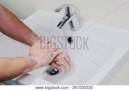 Washing Hands Rubbing With Soap Man For Covid-19 Prevention In Hospital. Cleaning To Stop Spreading