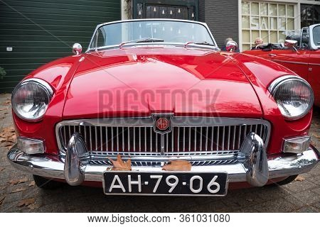 Usselo, Netherlands - October 21, 2018: Front View Of A Classic 1966 Mg B Type Roadster At A Meeting