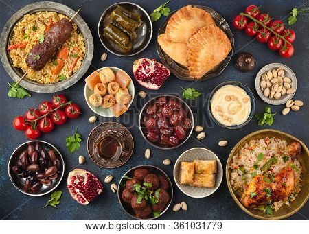 Ramadan Kareem Iftar Party Table With Assorted Festive Traditional Arab Dishes, Sweets, Dates. Eid A