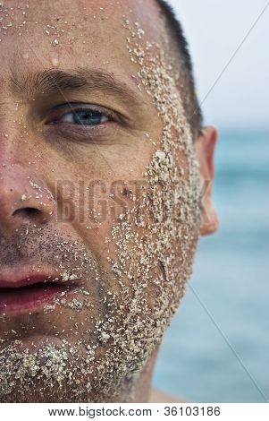 Half Face Covered With Sand