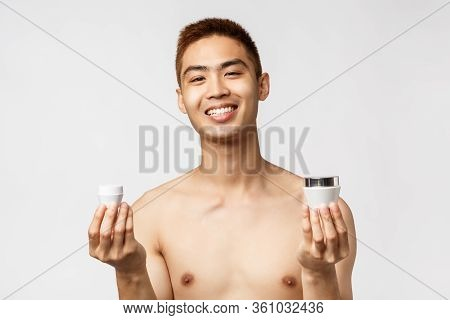 Beauty, People And Leisure Concept. Portrait Of Enthusiastic, Handsome Man In Naked Torso, Holding T