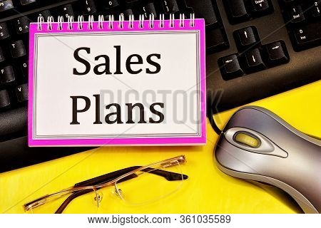 Sales Plan-writing On A Notepad. Long-term Vision Of Future Actions, Development Of A Method For Ach