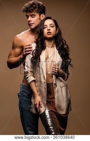 Sensual Shirtless Boyfriend Hugging Passionate Half Naked Girlfriend In Beige Jacket On Beige