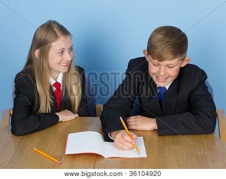 Two Schoolchildren Doing Homework
