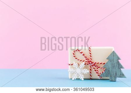 Christmas Gift Boxes On Pastel Background. Composition.