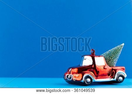 Christmas Car On Pastel Color Background. Christmas Or New Year Minimal Concept.