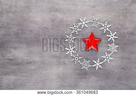 Christmas Composition. White Snow Flakes Wreath Decorations On Gray Background. Christmas, Winter, N