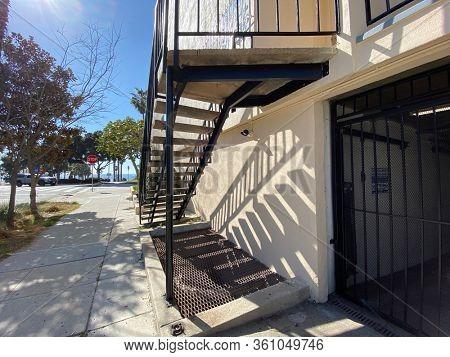 Sidewalk to ocean front sunny street stairway. Santa Monica, California.