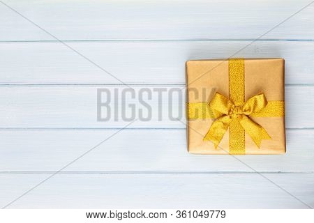 Gift Or Present Box On Color Table Top View. Flat Lay Composition For Birthday, Mother Day Or Weddin