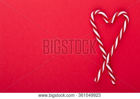 Christmas Candy Canes, Stick And Decor On Color Background. Sweet Christmas Card - Candy Canes With