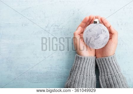 Vintage Christmas Background With Christmas Decoration In Women Hand. Christmas Greeting Card. Festi