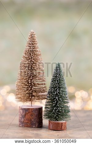 Colorful Christmas Tree On Green, Bokeh Background.