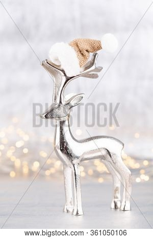 Christmas Reindeer On Bokeh Silver Background. Christmas Or New Year Minimal Concept.