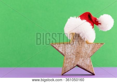 Christmas Star, Decor On Pastel Colored Background. Christmas Or New Year Minimal Concept.