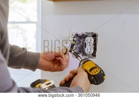 Work On Installing Electrical Outlets With Electrical Wires And Connector Installed In Plasterboard