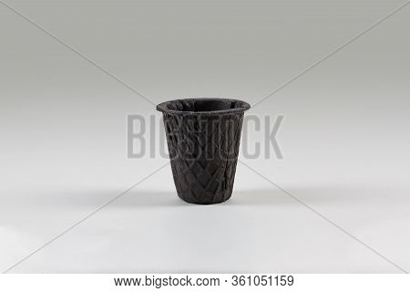Empty, Palatable, Black Wafer Cup For Ice Cream Isolated On White. Concept Of Food, Treats. Mockup,