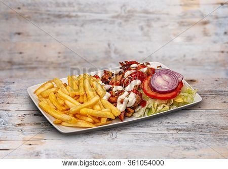 Gyros Souvlaki And French Fries In White Plate On Wooden Table