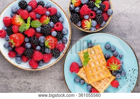 Fresh Berries Salad In A Plate On A  Wooden Background. Flat Lay, Top View, Copy Space.