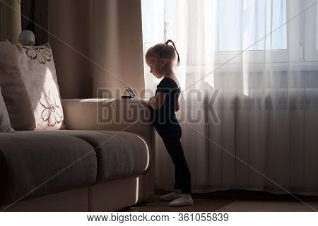 Little Girl Ballerina In Black Dress Practicing Classic Choreography During Online Class In Ballet S