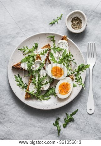 Delicious Breakfast, Brunch Or Snack - Cheese Toast, Arugula Salad And Soft Boiled Egg On A Grey Bac