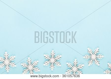 Christmas Background. White Snow Decorations On A Pink Background.